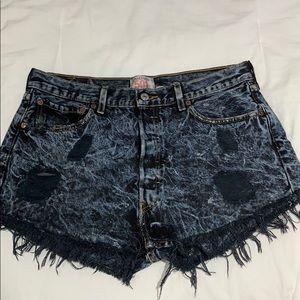 Distressed tie-dye denim shorts